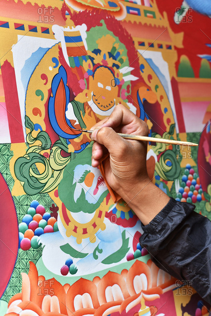 Nepal - April 15, 2016: Nepali man painting religious art
