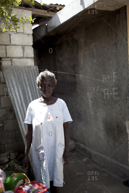 Haiti - February 20, 2011: Portrait of a Haitian woman standing outside