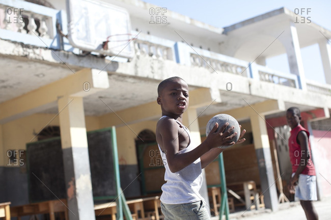 Haiti - February 24, 2011: Boys playing with small basketball