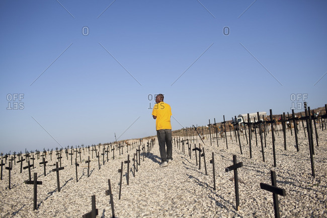 Haiti - February 25, 2011: Man walking through the Haitian National Memorial