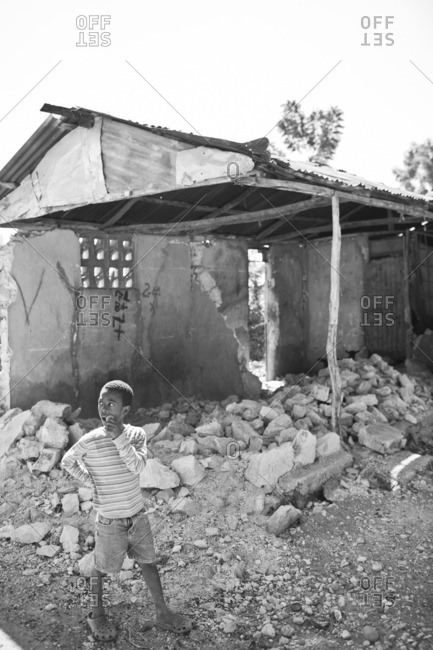 Haiti - February 25, 2011: Boy walking among rubble in Haiti