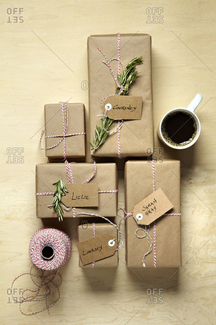 Holiday gifts wrapped with string and a cup of coffee