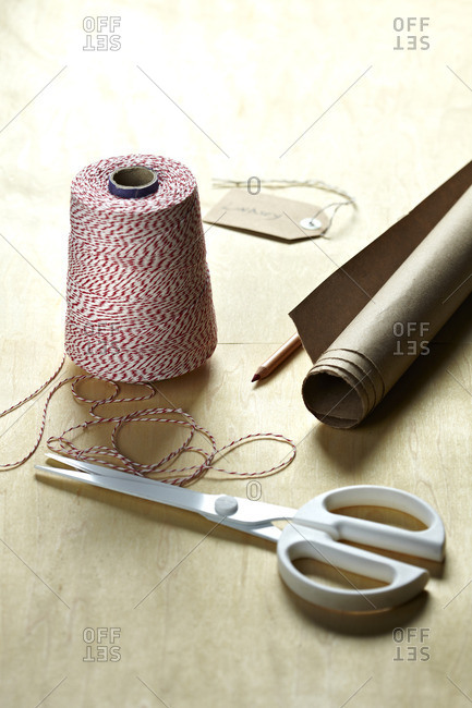 Gift wrapping supplies on wood table
