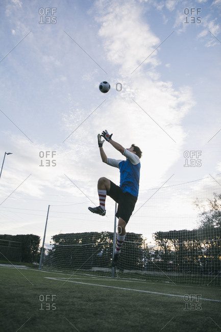 Goalkeeper trying to catch football