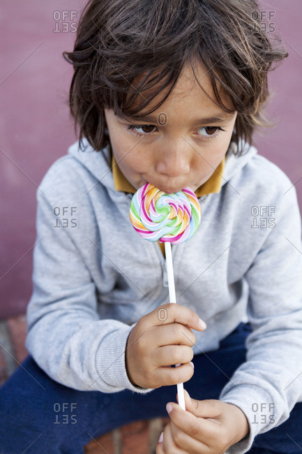 Portrait of little boy with lollipop