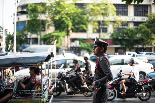 Bangkok, Thailand - May 10, 2012: Royal police officer with walkie talkie in Bangkok, Thailand