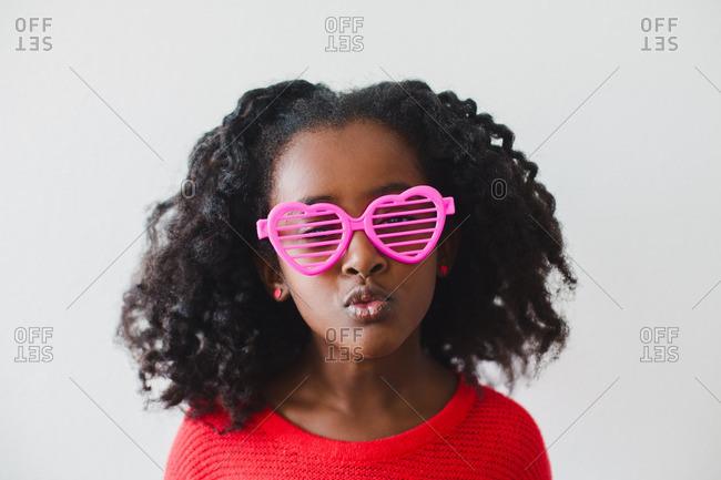 Girl in heart shaped sunglasses