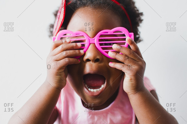 Funny girl in heart sunglasses