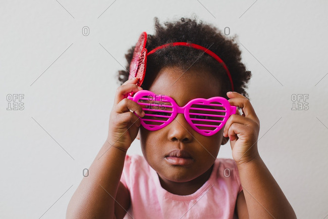 Girl in heart sunglasses