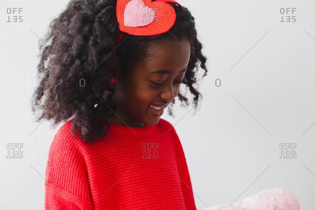 Girl with heart shaped headband