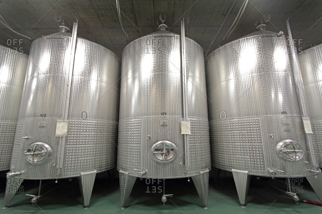 Stainless steel vats in an industrial wine cellar
