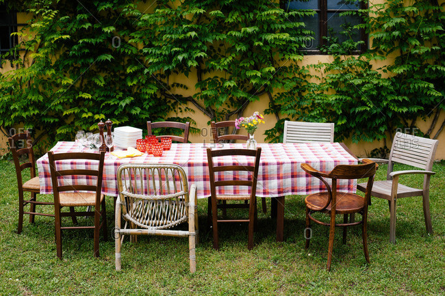 Table and chairs in garden ready for family meal
