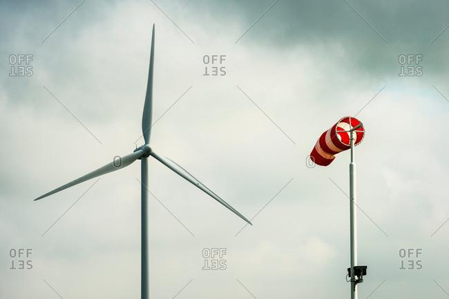 Wind turbine and windsock, Zeeland, Netherlands
