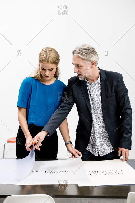 Two business people in discussion an ad campaign at an office