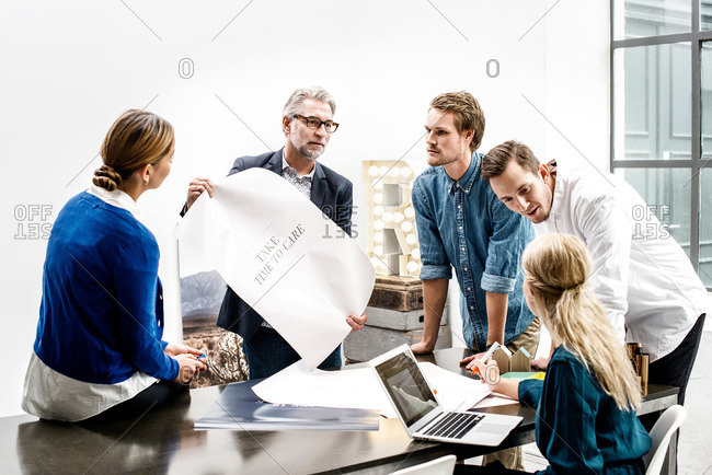 Business people in meeting about an ad campaign at an office