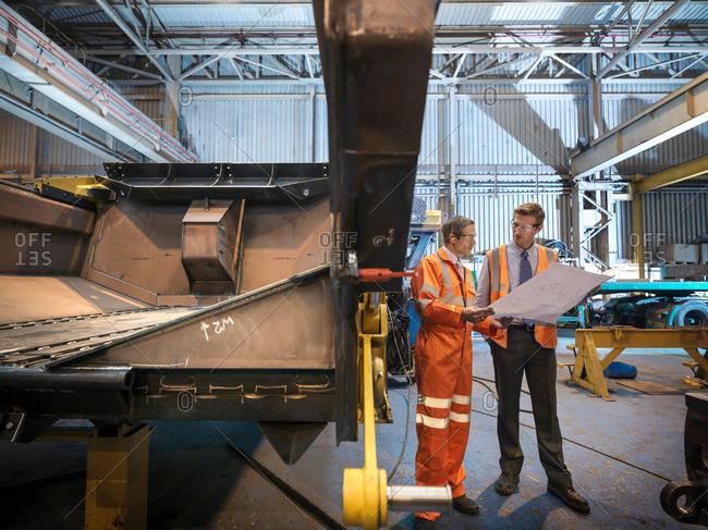 Engineers inspecting engineering drawings - Offset