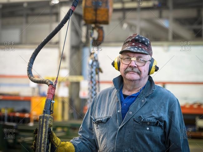 Portrait of crane operator in factory