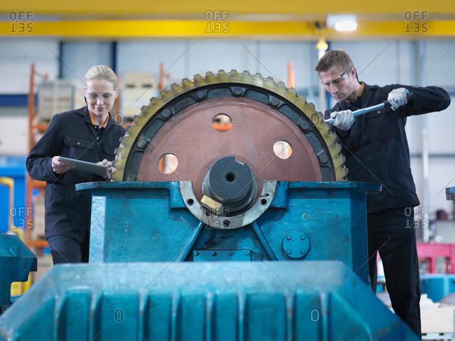 Engineers repair industrial gearbox