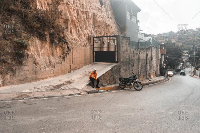 Caracas, Venezuela - January 2, 2016: Young boy seen on the side of the street