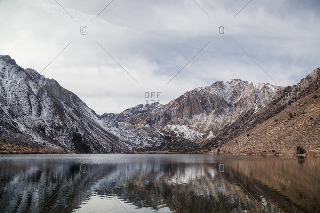 Snow covered mountains on the edge of a lake