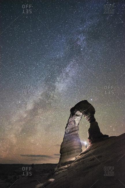 Delicate Arch illuminated at night