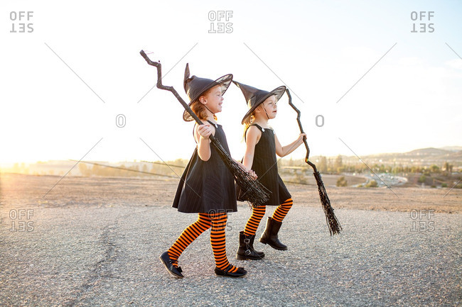 Girls in matching witch costumes
