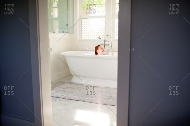Girl laughing in a tub