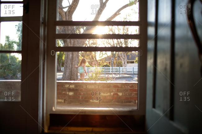 Girl in swimsuit seen from window