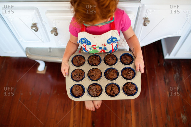 Girl holding baked muffins