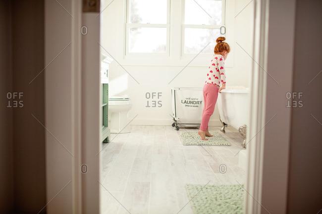 Girl looking into bathtub