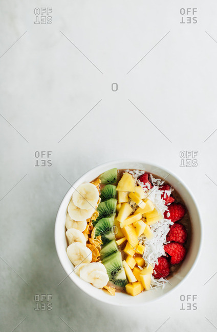 Overhead view of a bowl of sliced fruit