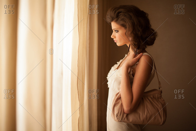 Attractive woman gazing out window