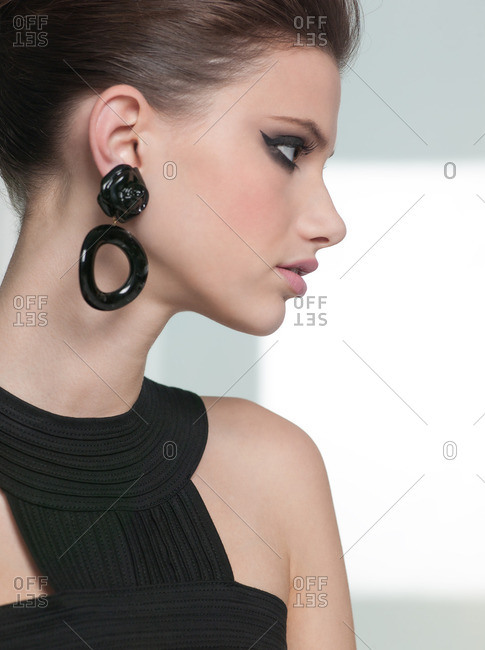 Profile of a woman with heavy eye makeup