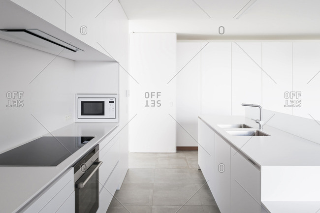 March 13, 2015: A modern white kitchen