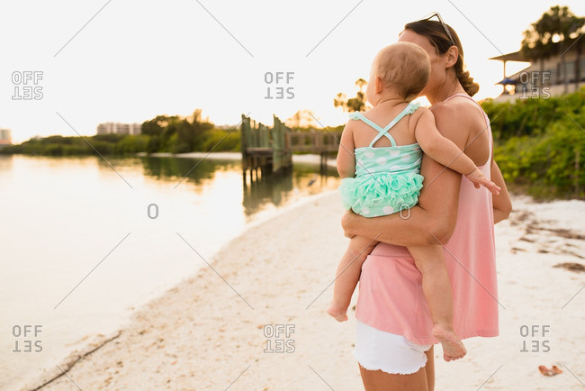 Woman with toddler on beachfront