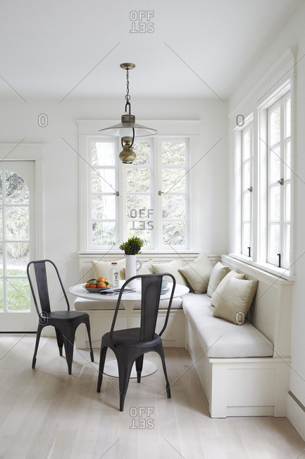 Breakfast nook with antique light fixture