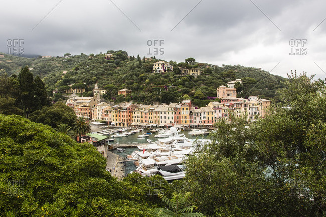 Buildings and mountains lining the waterfront at Portofino, Italy