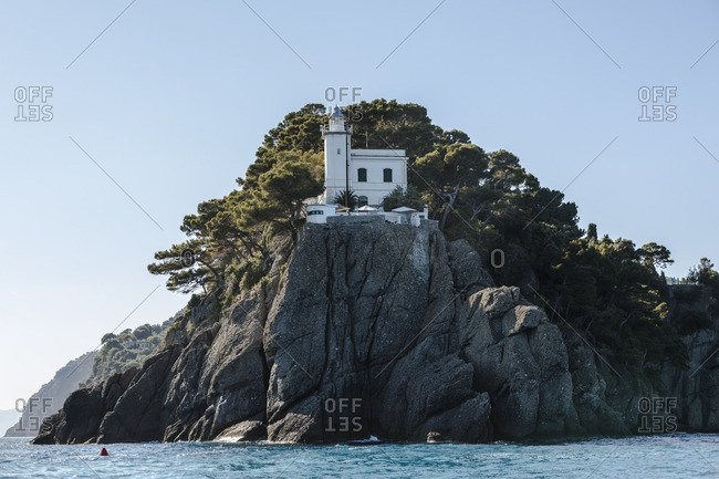 Lighthouse on a sheer cliff at Portofino, Italy