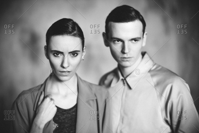 Model couple posing in jackets