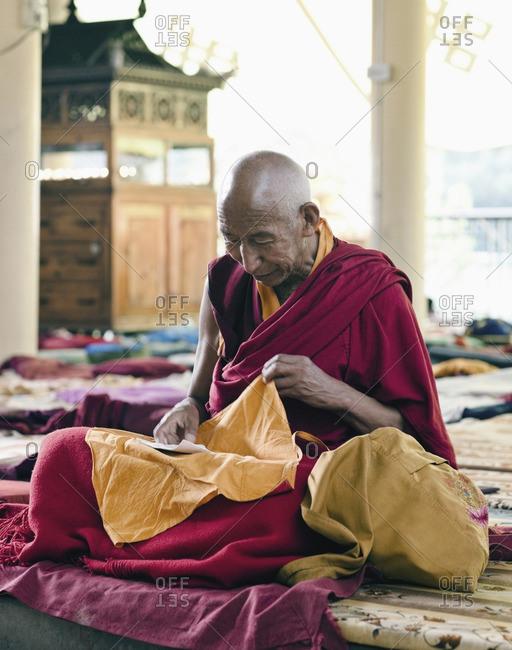 McLeod Ganj, Dharamsala, India - October 3, 2008: A Tibetan monk prays at the Dalai Lama's temple