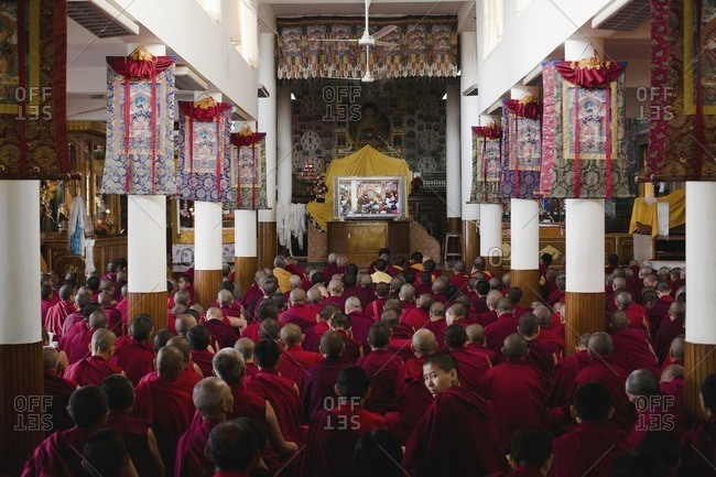 McLeod Ganj, Dharamsala, India - October 3, 2008: Female Tibetan Monks watch a lecture by the Dali Lama in the main temple at Mcleod Ganj, Dharamsala, India