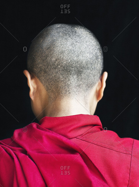 McLeod Ganj, Dharamsala, India - October 6, 2008: Rear view of a Tibetan nun/monk