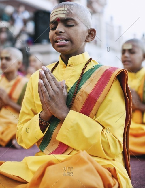Rishikesh, India - October 15, 2008: Young boys pray and chant at the Ganga Aarthi ritual