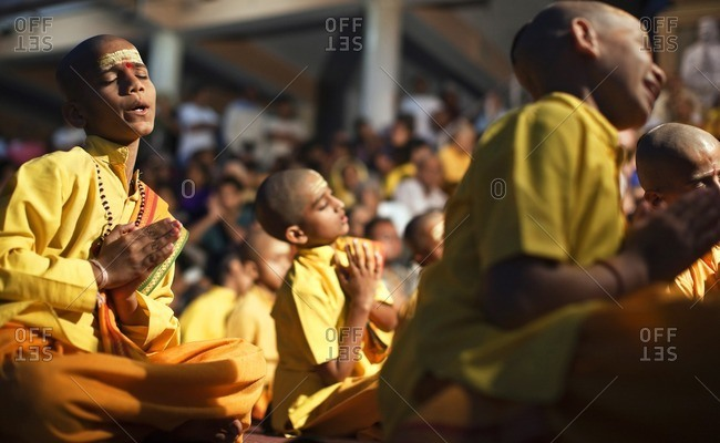 Rishikesh, India - October 15, 2008: Group of young boys pray and chant at the Ganga Aarthi ritual