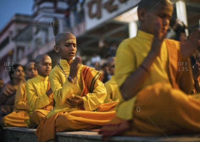 Rishikesh, India - October 15, 2008: Group of boys pray and chant at the Ganga Aarthi ritual