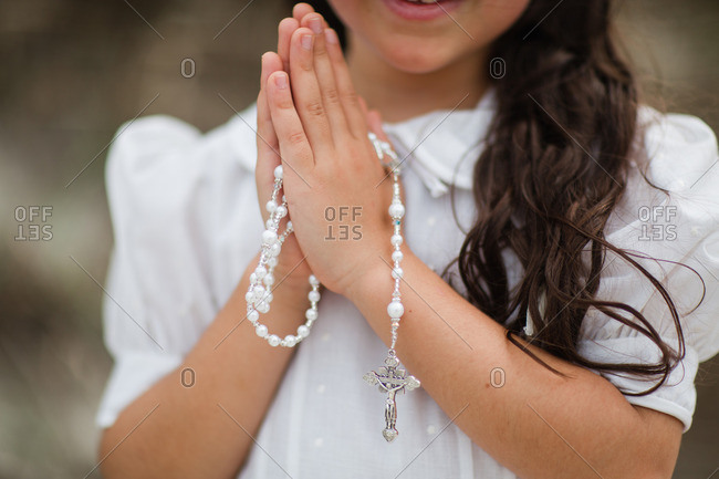 Close-up of young girl with rosary beads