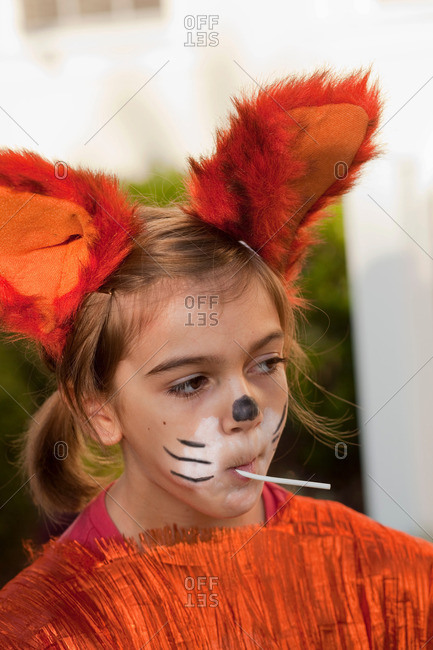 ... Little girl in fox costume sucking on lollipop  sc 1 st  Offset by Shutterstock : fox face costume  - Germanpascual.Com