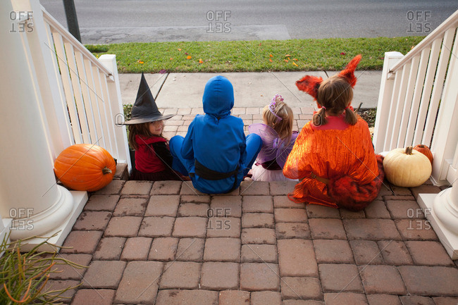 Children enjoying candy on steps