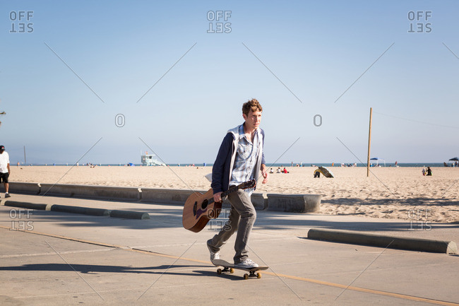 Young man skateboarding, Santa Monica Pier, Santa Monica Beach, US