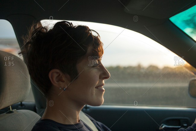 Mid adult woman driving in car